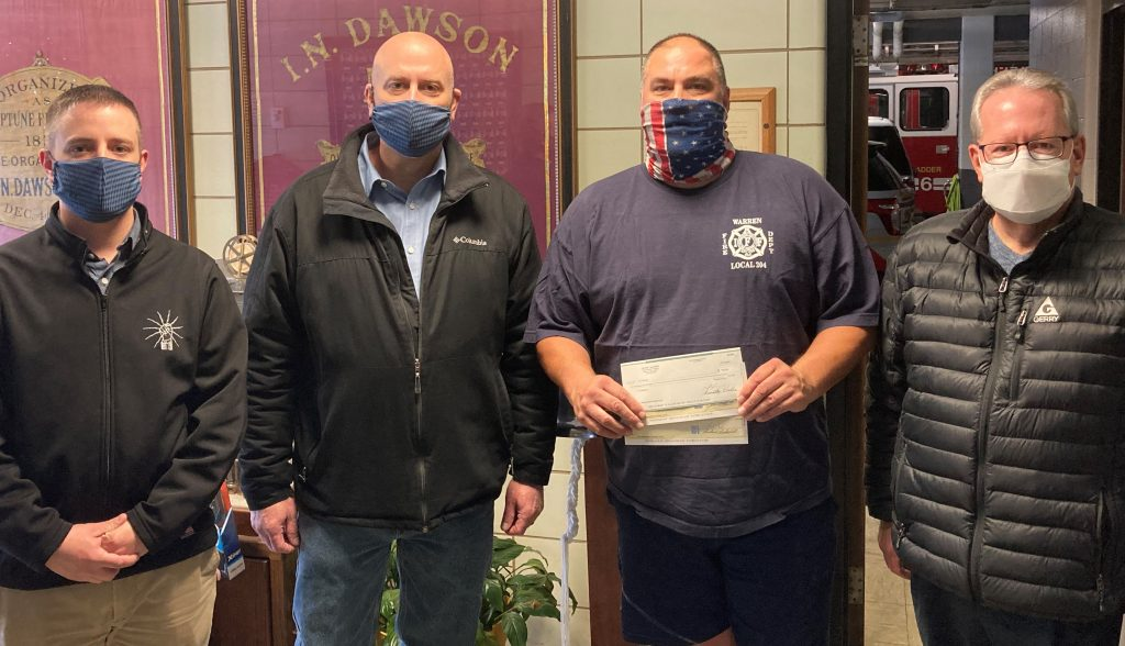 electricians presenting check