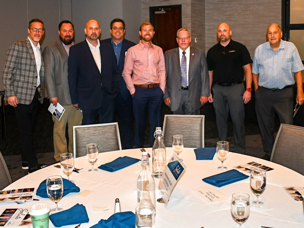 LMCC committee members stand together during the Youngstown Warren Regional Chamber meeting.