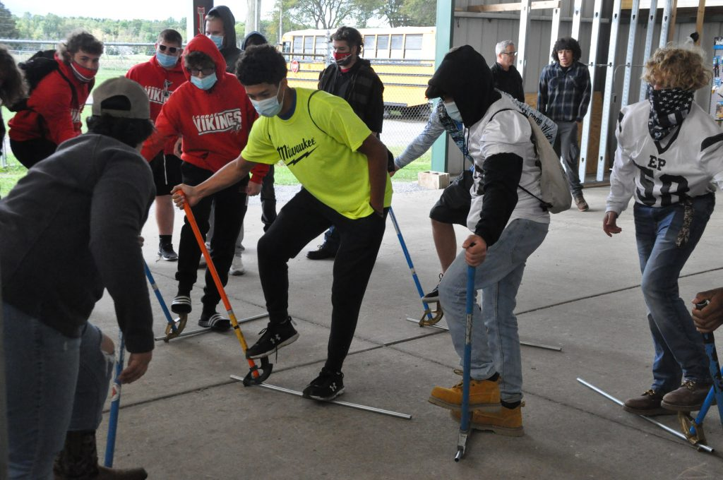 High school students learn to bend conduit.