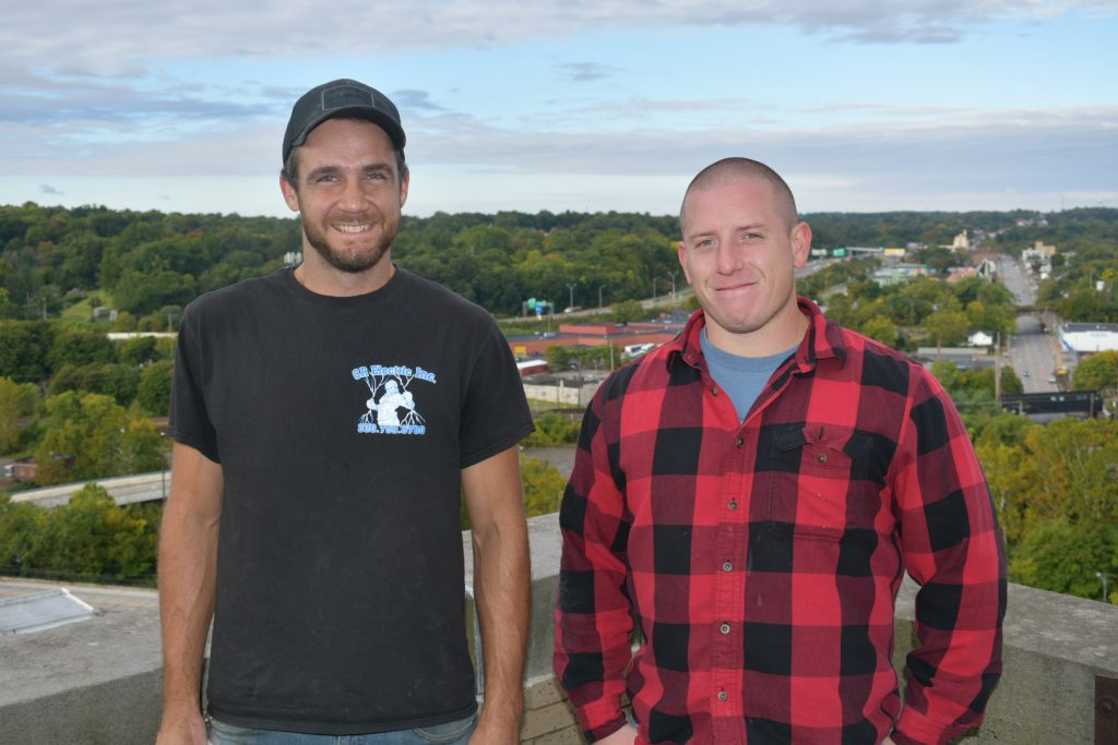 CR Electric crew standing atop Premier Bank tower
