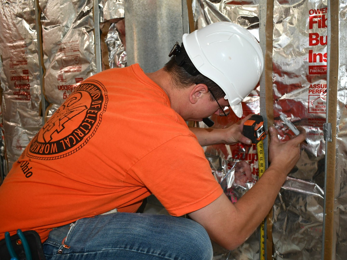 electrician wiring a building