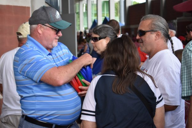 Member contractors were on hand to pass out branded flying discs as fans entered the stadium.