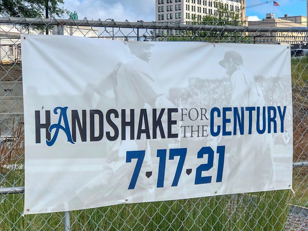 Handshake for the Century signage