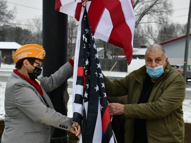 Dan Santon raising flag