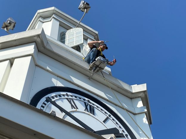 Man outside of clock tower