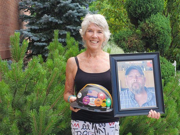 mary ann wilson holds photo of son